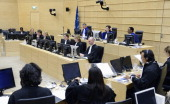 Members of the International Criminal Court take part in a hearing concerning the trial of Kenyans charged with crimes that took place during...