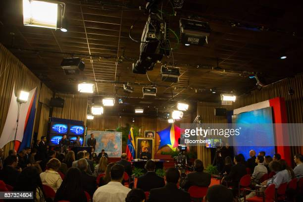 Members of the international media sit while Nicolas Maduro Venezuela's president speaks during a news conference in Caracas Venezuela on Tuesday Aug...