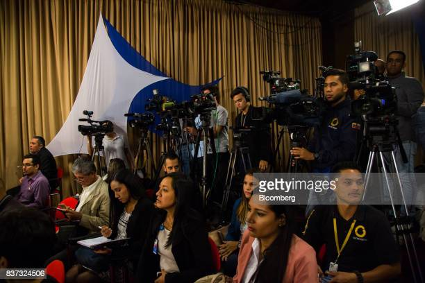 Members of the international media wait for Nicolas Maduro Venezuela's president before the start of a news conference in Caracas Venezuela on...