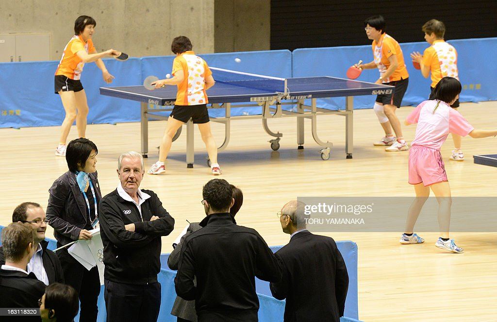 Members of the International Olympic Committee (IOC) evaluation commission led by Craig Reedie (4th L), watch table tennis players during their visit to Tokyo Metropolitan Gymnasium, a potential location for the 2020 Olympic Games table tennis, in Tokyo on March 5, 2013. Japan's corporate giants are ready to chip in for another Summer Olympics in Tokyo, hoping the Games will provide the same economic boost as the 1964 edition, Toyota's chairman said on march 5. AFP PHOTO / Toru YAMANAKA