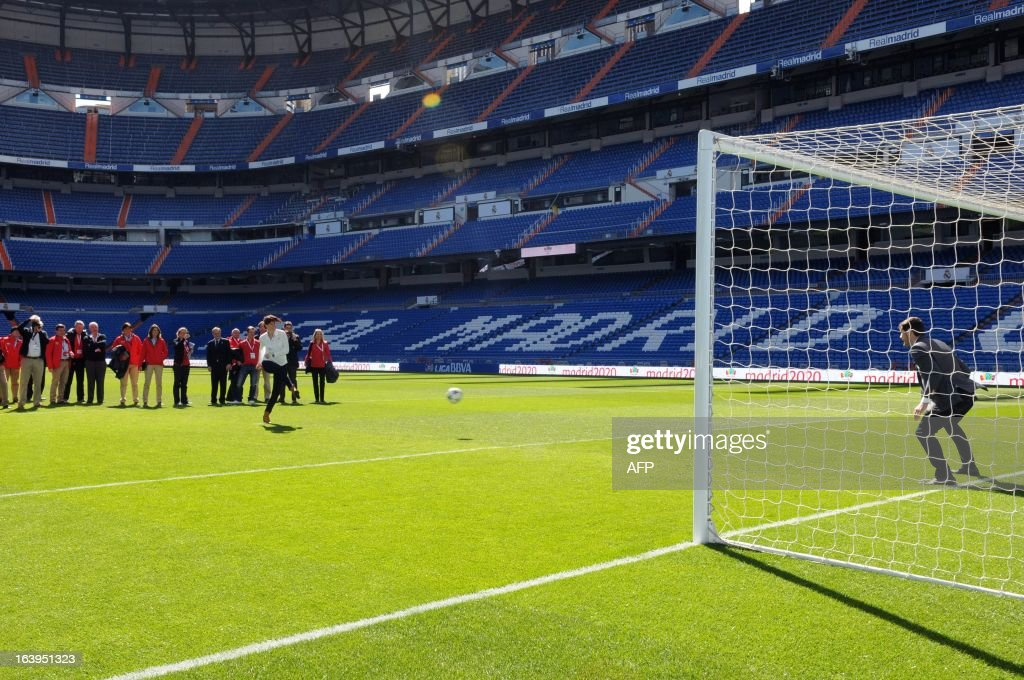 Members of the International Olympic Committee (IOC) evaluation team try to score past Real Madrid's goalkeeper and captain Iker Casillas during the IOC evaluation team's visit to the Santiago Bernabeu stadium in Madrid on March 18, 2013. Spanish Prime Minister Mariano Rajoy today opened the International Olympic Committee's (IOC) evaluation team's visit to Madrid by claiming the city deserves the right to host the 2020 Olympic Games. The evaluation committee will visit sites across the city for the next three days before filing their report to IOC members.