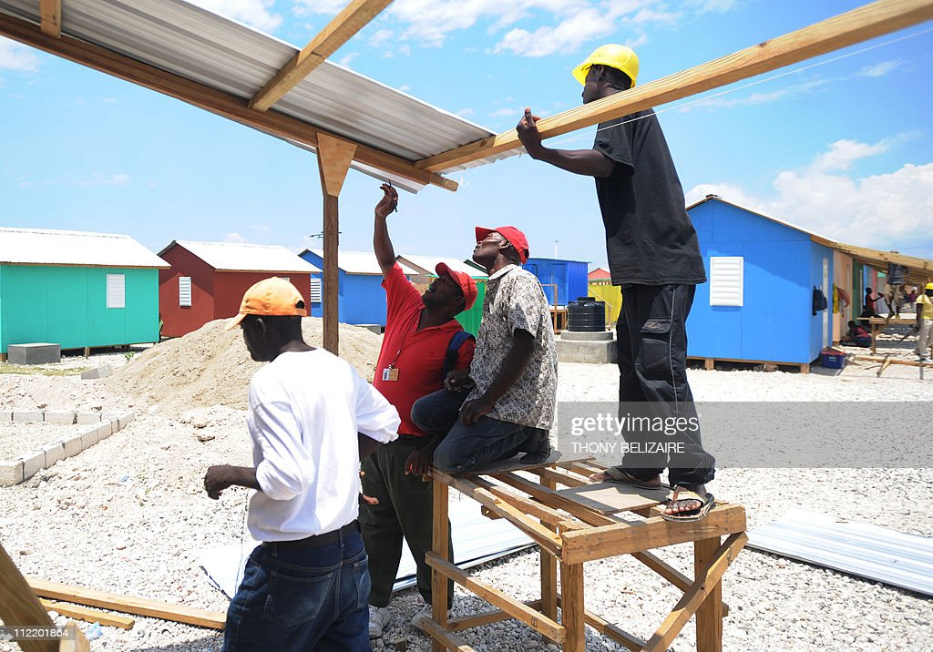 Members of the International Red Cross help to construct houses on April 14 2011 in PortauPrince The notoriously dysfunctional Caribbean nation was...