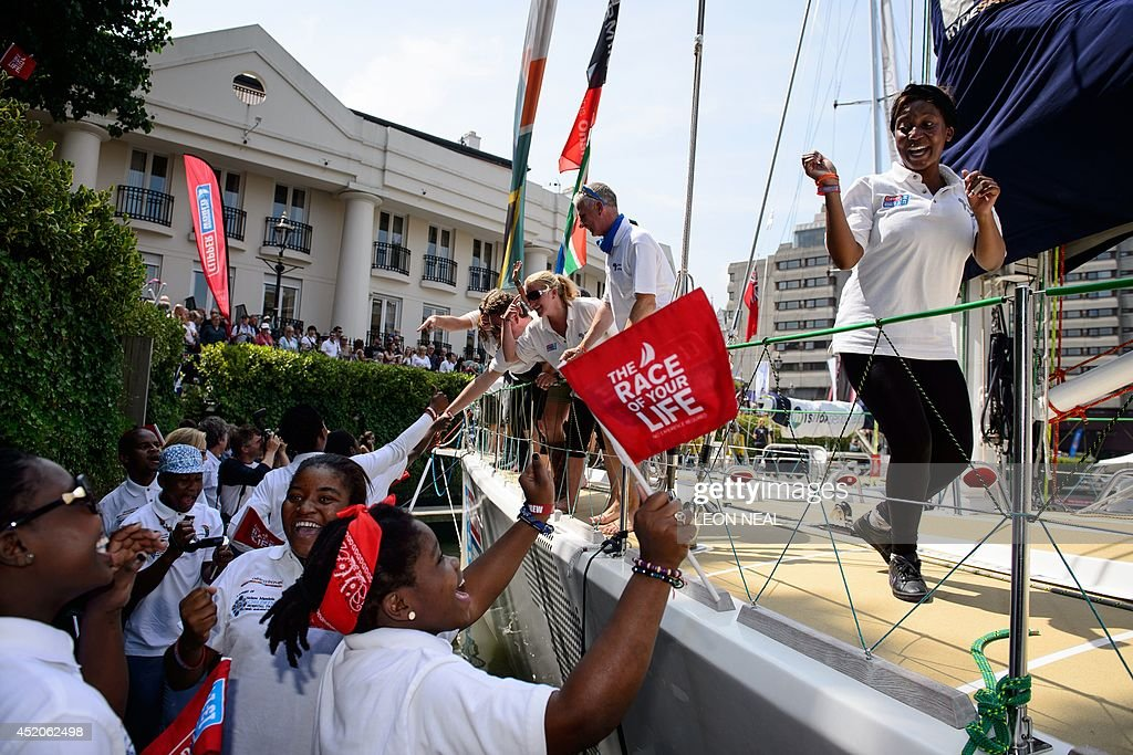 Members of the Invest Africa crew are welcomed into Saint Katherine's Dock in London, England after completing the 2013-14 Clipper Round the World Yacht Race, on July 12, 2014. The world's longest ocean race began on September 1, 2013, with a 12-strong fleet visiting 14 ports on six continents and travelling 40,000 miles before returning to the British capital. AFP PHOTO/Leon Neal