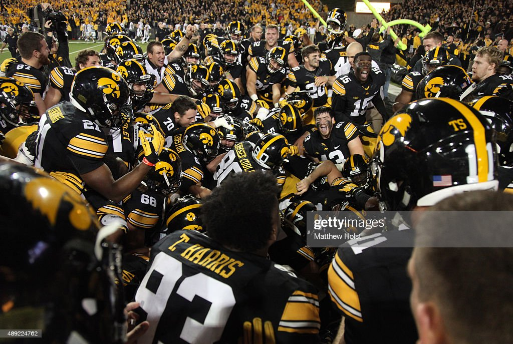 Members of the Iowa Hawkeyes celebrate in the end zone after a game winning field goal by kicker Marshall Koehn late in the second half against the...