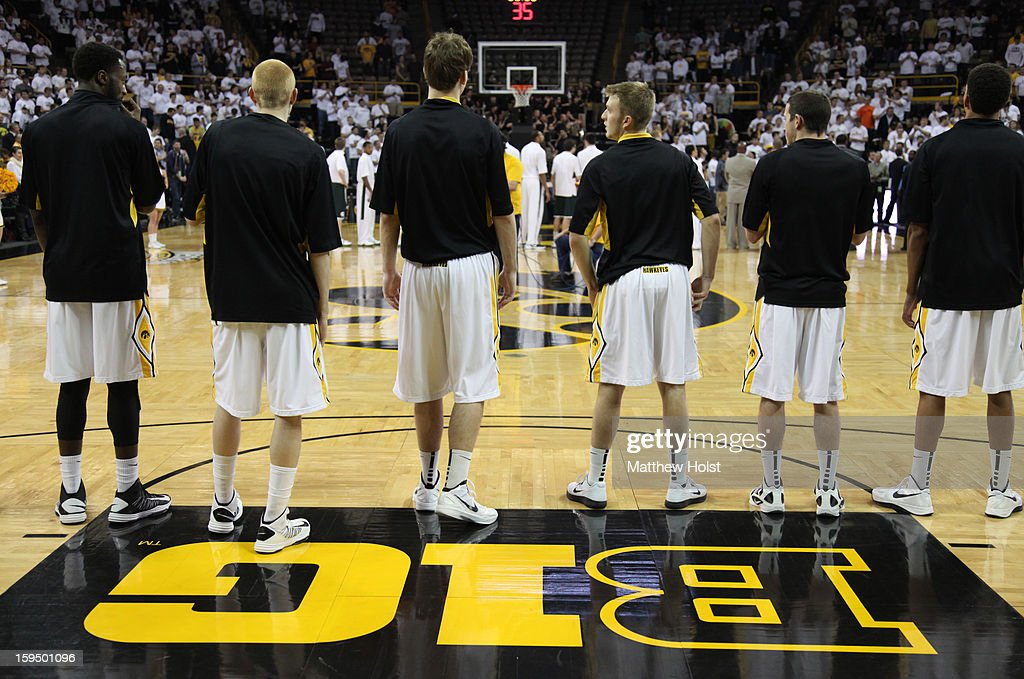 Members of the Iowa Hawkeyes line up for the national anthem before the match-up against the Michigan State Spartans on January 10, 2013 at Carver-Hawkeye Arena in Iowa City, Iowa. Michigan State won 62-59.