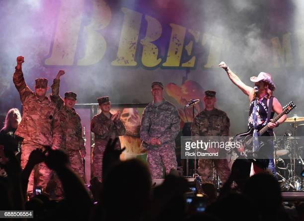 Members of The Iowa National Guard Tasha Throndson Andrew V Johnson Matt Pentico Grant Lehman and Symone Frakes join Bret Michaels on stage at Tree...