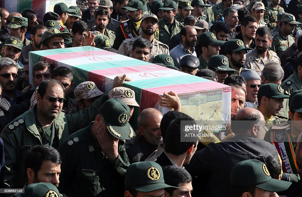 Members of the Iranian Revolutionary Guard carry the casket of Iran's Revolutionary Guards Brigadier General Mohsen Ghajarian, who was reportedly killed in the northern province of Aleppo in the fight against the Islamic State (IS) jihadist group, during his funeral procession in the capital Tehran, on February 6, 2016. Brigadier General Mohsen Ghajarian of the elite Revolutionary Guards was killed in the northern province of Aleppo, according to the Fars news agency, which is close to the Guards. He was advising pro-government forces in the fight against the Islamic State (IS) jihadist group, it reported, without saying when he died. KENARE