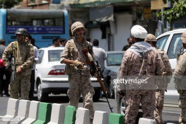 Members of the Iranian Revolutionary Guard secure the area outside the Iranian parliament during an attack on the complex in the capital Tehran on...