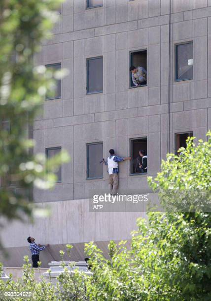 Members of the Iranian security forces are seen outside the Iranian parliament in the capital Tehran on June 7 2017 during an attack on the complex...