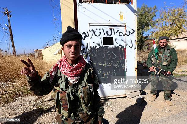 Members of the Iraqi autonomous Kurdish region's peshmerga forces pose for a photo as they enter the northern Iraqi town of Sinjar in the Nineveh...