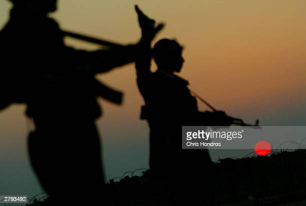 Members of the Iraqi Civil Defense Corps halts a car at a checkpoint December 8 2003 in near Samarra Iraq US forces want the nascent Iraqi Civil...