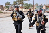 Members of the Iraqi Emergency Response Brigade patrol streets on June 24 2014 in the western city of Ramadi in the Anbar province where government...