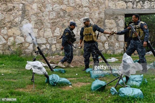 Members of the Iraqi Federal Police fire mortars towards positions held by the Islamic State group on the front line of the attack on West Mosul on...