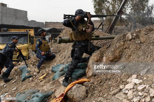 Members of the Iraqi Federal Police fire towards positions held by the Islamic State group on the front line of the attack on West Mosul on April 23...
