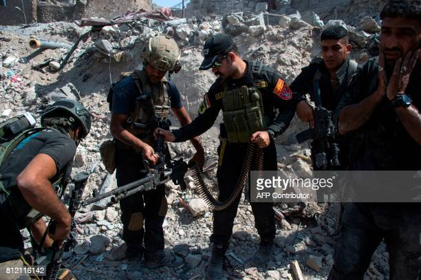 Members of the Iraqi forces are seen in the Old City of Mosul on July 10 during the offensive to retake the embattled city from Islamic State group...
