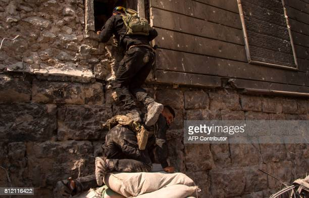 TOPSHOT Members of the Iraqi forces are seen in the Old City of Mosul on July 10 during the offensive to retake the embattled city from Islamic State...