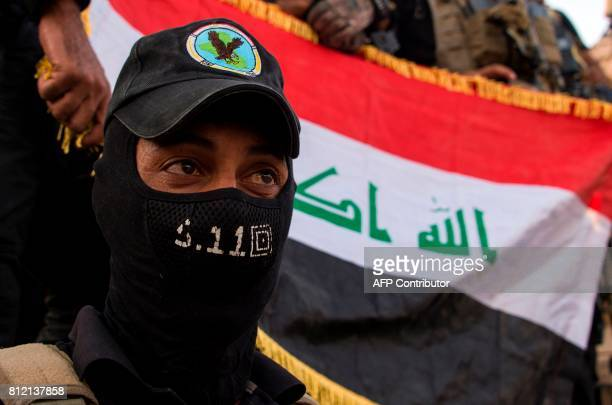 Members of the Iraqi forces celebrate in the Old City of Mosul on July 10 2017 after the government's announcement of the 'liberation' of the...