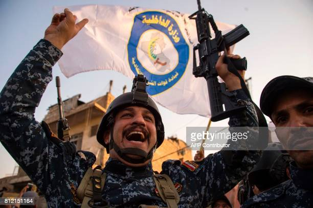 TOPSHOT Members of the Iraqi forces celebrate in the Old City of Mosul on July 10 2017 after the government's announcement of the 'liberation' of the...