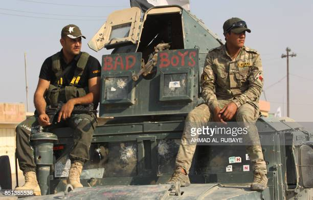 Members of the Iraqi forces ride on a humvee during the advance towards the northern Iraqi town of Sharqat on September 22 2017 Iraqi forces achieved...