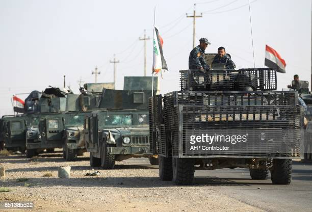Members of the Iraqi forces ride on humvees during the advance towards the northern Iraqi town of Sharqat on September 22 2017 Iraqi forces achieved...