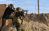 TOPSHOT CORRECTION Members of the Iraqi government forces battle with Islamic State group fighters east of Ramadi after they took control of the...