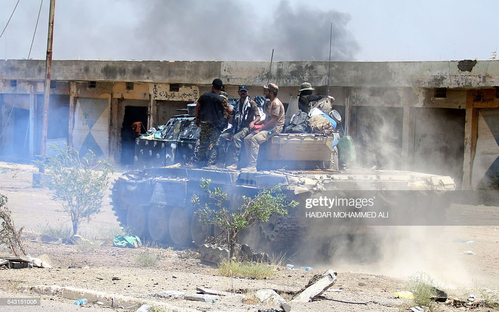 Members of the Iraqi government forces sit on a tank in Fallujah, 50 kilometres (30 miles) from the capital Baghdad, after forces retook the embattled city from the Islamic State group on June 26, 2016. Iraqi Prime Minister Haider al-Abadi urged all Iraqis to celebrate the recapture of Fallujah by the security forces and vowed the national flag would be raised in Mosul soon. While the battle has been won, Iraq still faces a major humanitarian crisis in its aftermath, with tens of thousands of people who fled the fighting desperately in need of assistance in the searing summer heat. ALI