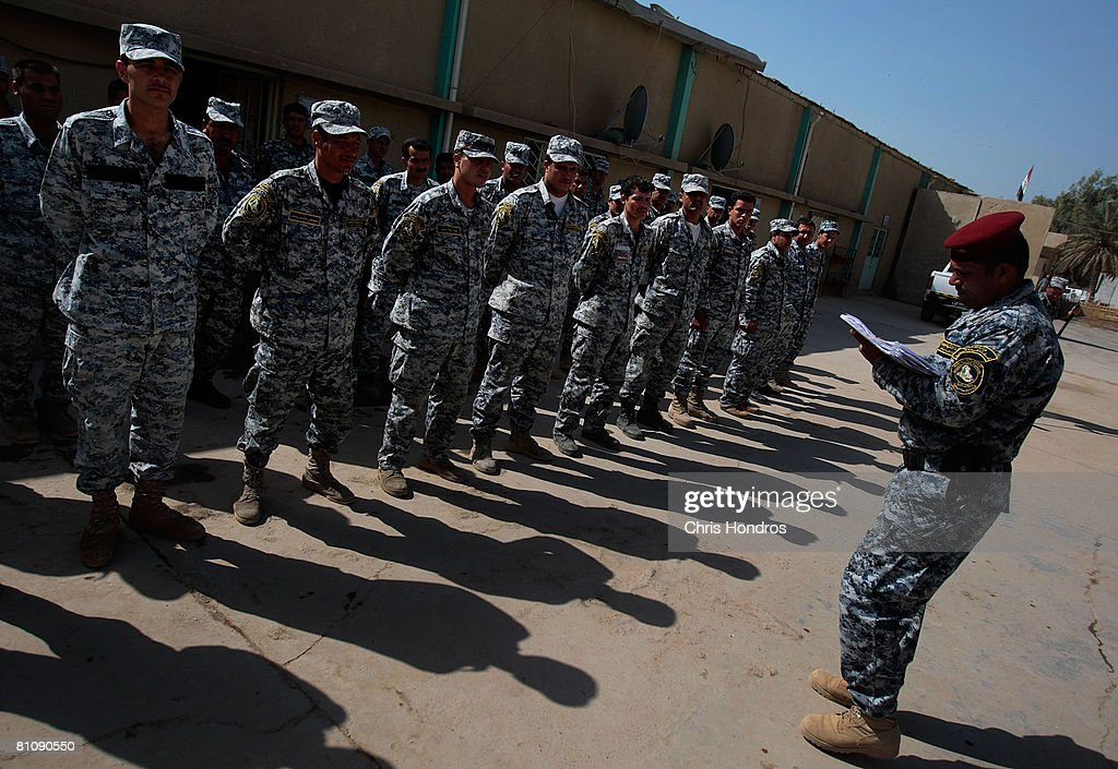 Members of the Iraqi National Police line up for morning roll call in the Baladiyat neighborhood May 15, 2008 in Baghdad, Iraq. The US Army's 10th Mountain Division soldiers take daily joint patrols with the Iraqi National Police, in the ongoing effort to build up stable national Iraqi security institutions aligned with the national government.