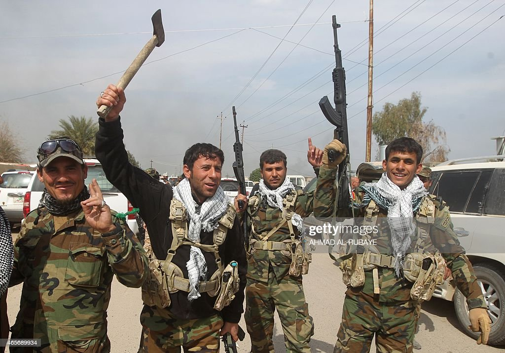 Members of the Iraqi paramilitary Popular Mobilisation units which are dominated by Shiite militias celebrate after regaining control of the village...