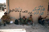 TOPSHOT Members of the Iraqi Popular Mobilisation units rest on a street in Fallujah 50 kilometres from the capital Baghdad after they retook the...