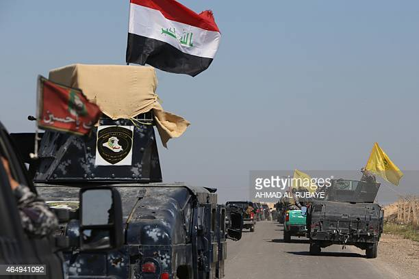 Members of the Iraqi security forces coming from the city of Samarra north of Baghdad drive towards alDawr area located south of Tikrit to launch an...