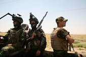 Members of the Iraqi security forces keep watch on August 14 2014 on the main highway near Ramadi Anbar's provincial capital west of Baghdad which...