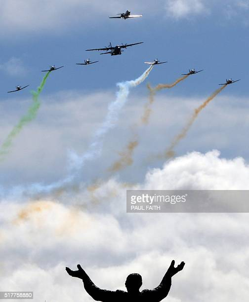 Members of the Irish Air Corps perform a flypast over the General Post Office the scene of the 1916 Easter Rising in Dublin on March 27 2016 during a...