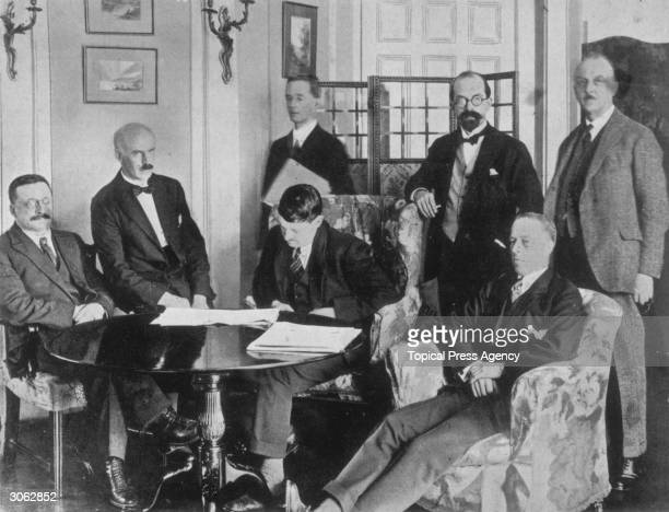 View of members of the Irish delegation at the signing of the Irish Free State Treaty between Great Britain and Ireland London England December 6...