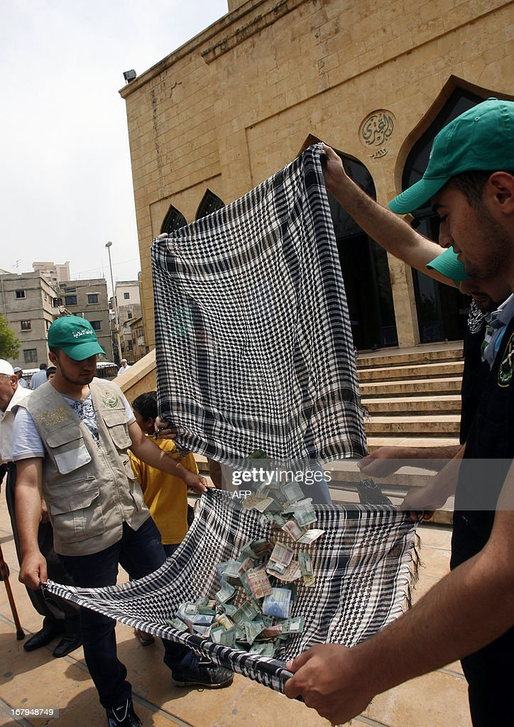 Members of the Islamic Group, Jamaa Islamiya, collect money outside a mosque after the Friday prayers in order to 'help free Syrian Revolutionists', as mentioned in their statement on May 3, 2013 in the southern Lebanese city of Sidon. ZAYYAT