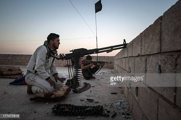 Members of the Islamic Kurdish Front aim their weapons at a position of fellow Kurdish fighters from the Committees for the Protection of the Kurdish...