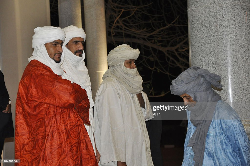 Members of the islamist Ansar Dine delegation, walk out after attending a mediation meeting with members of the Malian government and the Azawad National Liberation Movement (MNLA) Tuareg rebellion, hosted by the Burkina Faso President, in Ouagadougou, on December 4, 2012. Delegations from the Malian government and two rebel groups from the country's vast north held their first talks Tuesday to seek an end to the crisis that has split the west African the country in two. Burkina Faso President Blaise Compaore, west Africa's top mediator for the crisis, hosted the meeting in Ouagadougou, and brought together a Malian government delegation with representatives of Ansar Dine (Defenders of the Faith), one of the Al-Qaeda-linked Islamist groups occupying the north, and the Azawad National Liberation Movement (MNLA), which is fighting for an independent homeland for the Tuareg people.