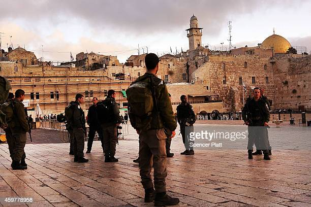 Members of the Israeli Defense Forces stand near the Western Wall at dawn on December 01 2014 in Jerusalem Israel As violence continues in Israel an...