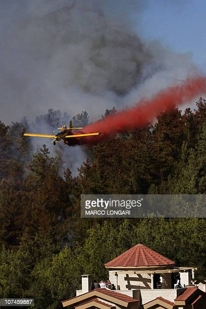Members of the Israeli Druze community look at the latest front of the raging flames near the village of Ussafiya in Haifa's Carmel forest on...