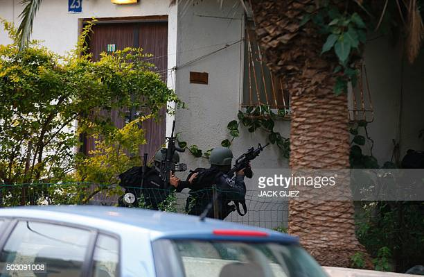Members of the Israeli security forces search the area following an attack by an unidentified gunman who opened fire at a pub in Tel Aviv killing two...