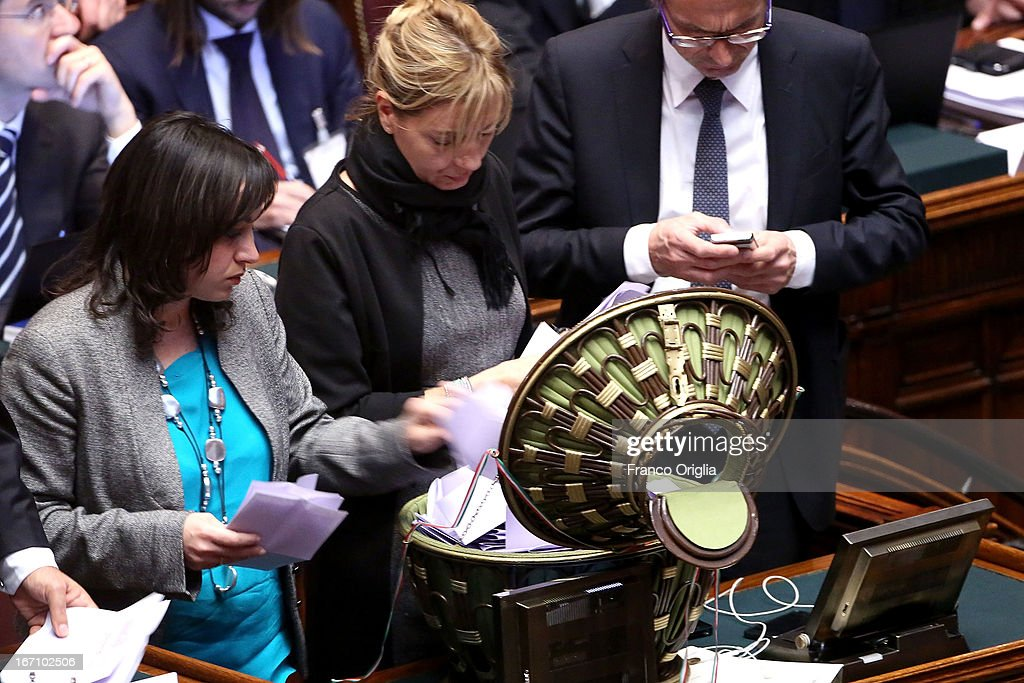 Members of the Italian Parliament check the ballot papers as Parliament votes for President of Republic on April 20, 2013 in Rome, Italy. After five ballots ended in deadlock the Italian Parliment has re-elected President Giorgio Napolitano for a second term following a last-minute deal between party chiefs.