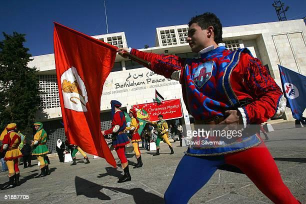 Members of the Italian troupe Spandieratori Delle Contrade Di Cori from the town of Cori near Rome try to bring some colour to Manger Square as they...