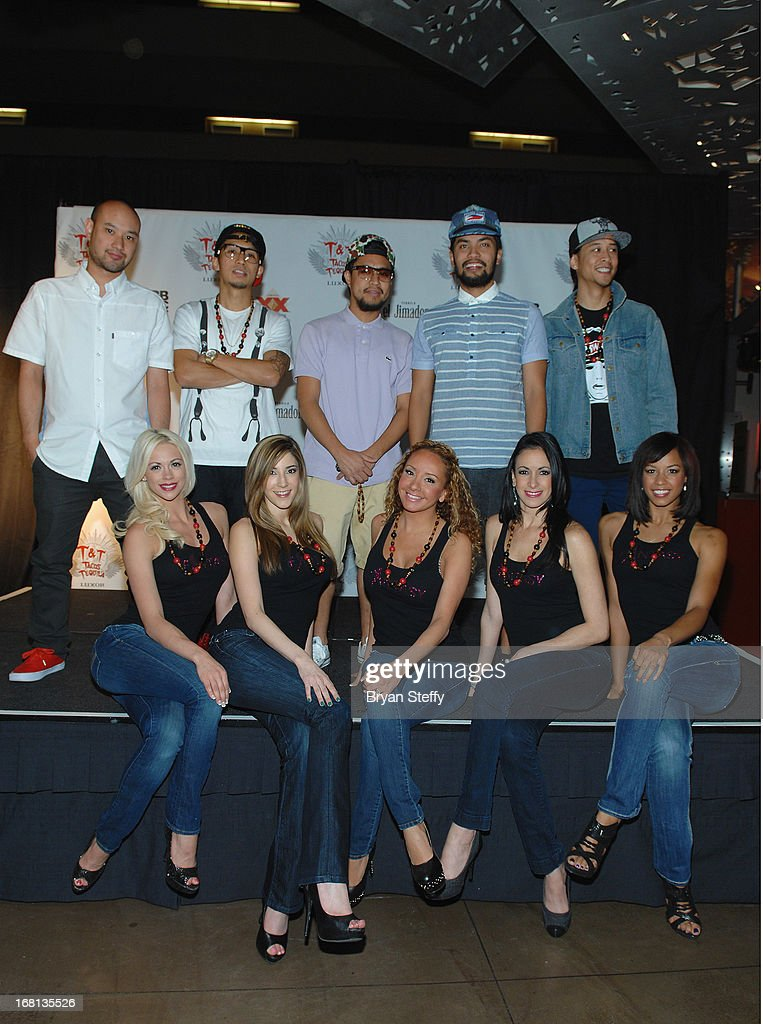 Members of the Jabbawockeez (L-R) Jeffrey Nguyen, Ben Chung, Phil Tayag, Christopher Gatdula, Josef Larot and (sitting) entertainers from the 'Fantasy' show at Luxor (L-R) Chloe Louise Crawford, Soolin, Lorena Peril, Yesi, and Ashton appear during Tacos & Tequila's Cinco de Mayo celebration at the Luxor Resort & Casino on May 5, 2013 in Las Vegas, Nevada.