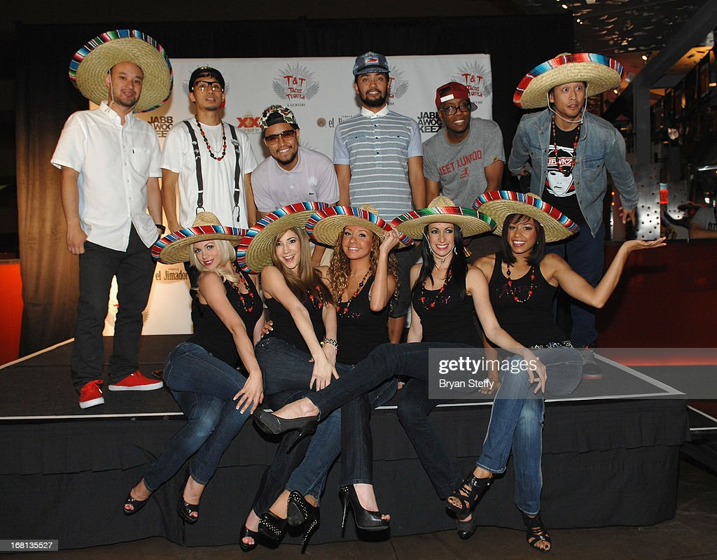 Members of the Jabbawockeez (L-R) Jeffrey Nguyen, Ben Chung, Phil Tayag, Christopher Gatdula, Kevin Brewer, Josef Larot and (sitting) entertainers from the 'Fantasy' show at Luxor (L-R) Chloe Louise Crawford, Soolin, Lorena Peril, Yesi, and Ashton appear during Tacos & Tequila's Cinco de Mayo celebration at the Luxor Resort & Casino on May 5, 2013 in Las Vegas, Nevada.