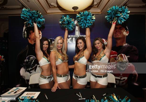 Members of the Jacksonville Jaguars Cheerleaders Chelsea Jennifer Monica and Heather pose during the NFL Superbash party and screening event for...