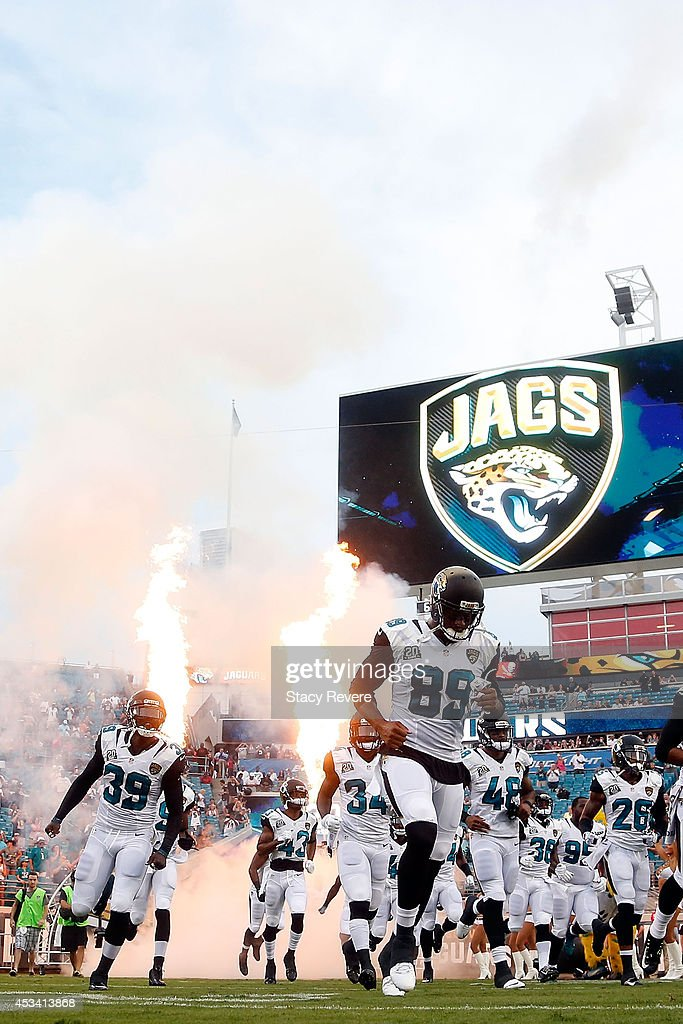 Members of the Jacksonville Jaguars take the field prior to a preseason game against the Tampa Bay Buccaneers at EverBank Field on August 8, 2014 in Jacksonville, Florida.