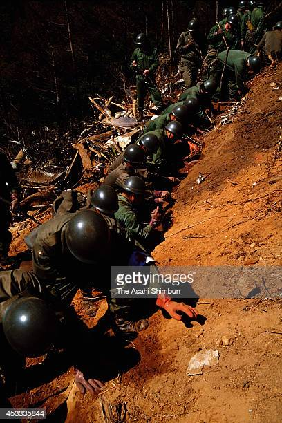 Members of the Japan Ground SelfDefense Force in a rescue operation at the crash site at the ridge of Mount Osutaka on August 15 1985 in Ueno Gunma...