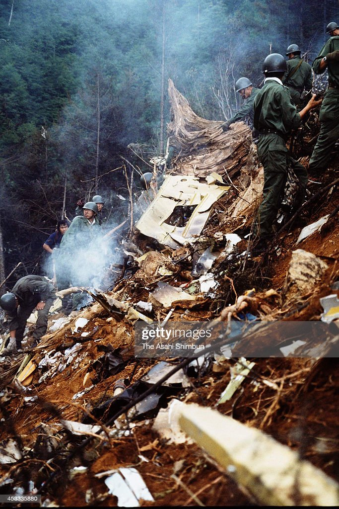 Members of the Japan Ground SelfDefense Force in a rescue operation at the crash site at the ridge of Mount Osutaka on August 13 1985 in Ueno Gunma...