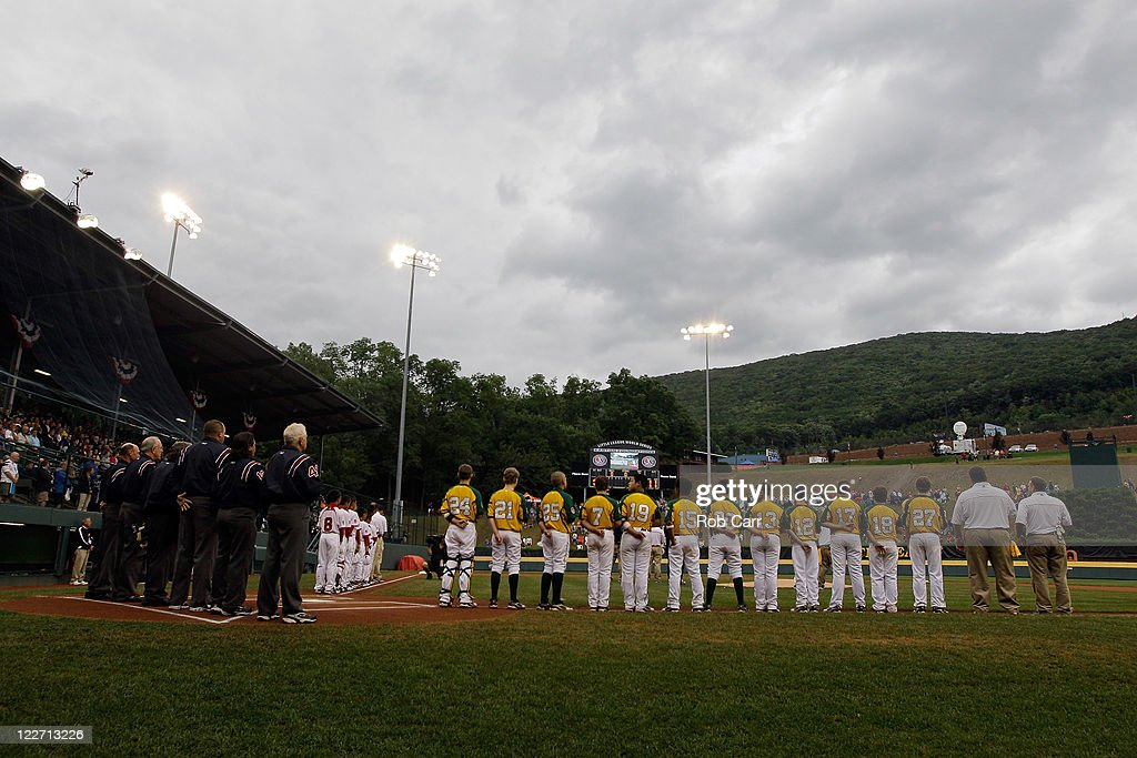 Members of the Japan team from Hamamatsu City, Japan (L) and the West team from Huntington Beach, California line up before the start of the Little League World Series championship game on August 28, 2011 in South Williamsport, Pennsylvania. The West team defeated the team from Japan 2-1.