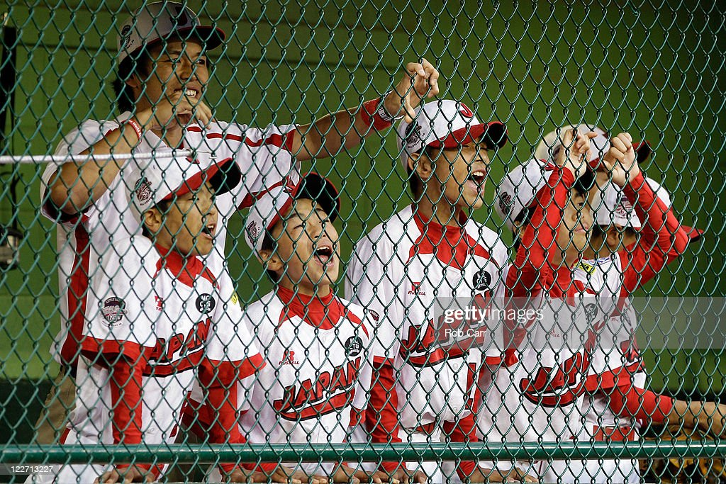 Members of the Japan team from Hamamatsu City, Japan cheer on their team from the dugout against the West team from Huntington Beach, California during the Little League World Series championship game on August 28, 2011 in South Williamsport, Pennsylvania. The West team defeated the team from Japan 2-1.