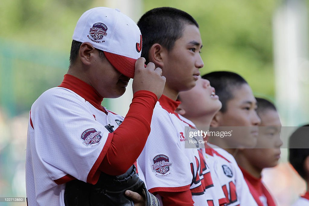 Members of the Japan team from Hamamatsu City, Japan react after losing to the West team from Huntington Beach, California 2-1 during the Little League World Series championship game on August 28, 2011 in South Williamsport, Pennsylvania.